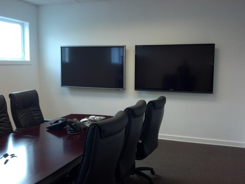 Two conference room monitors