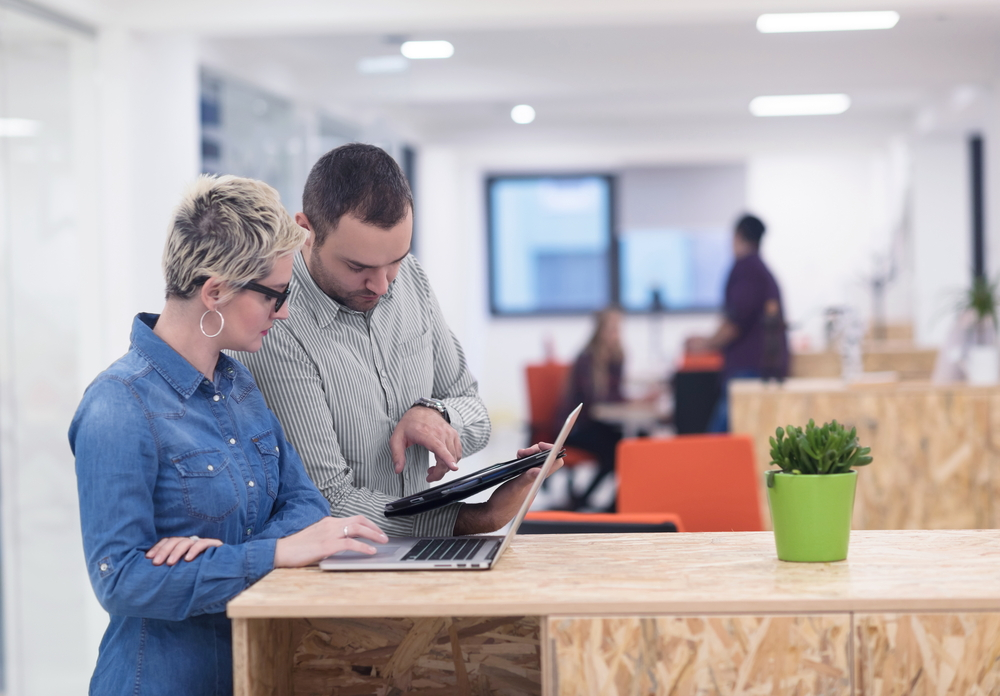Two business people looking at a tablet computer